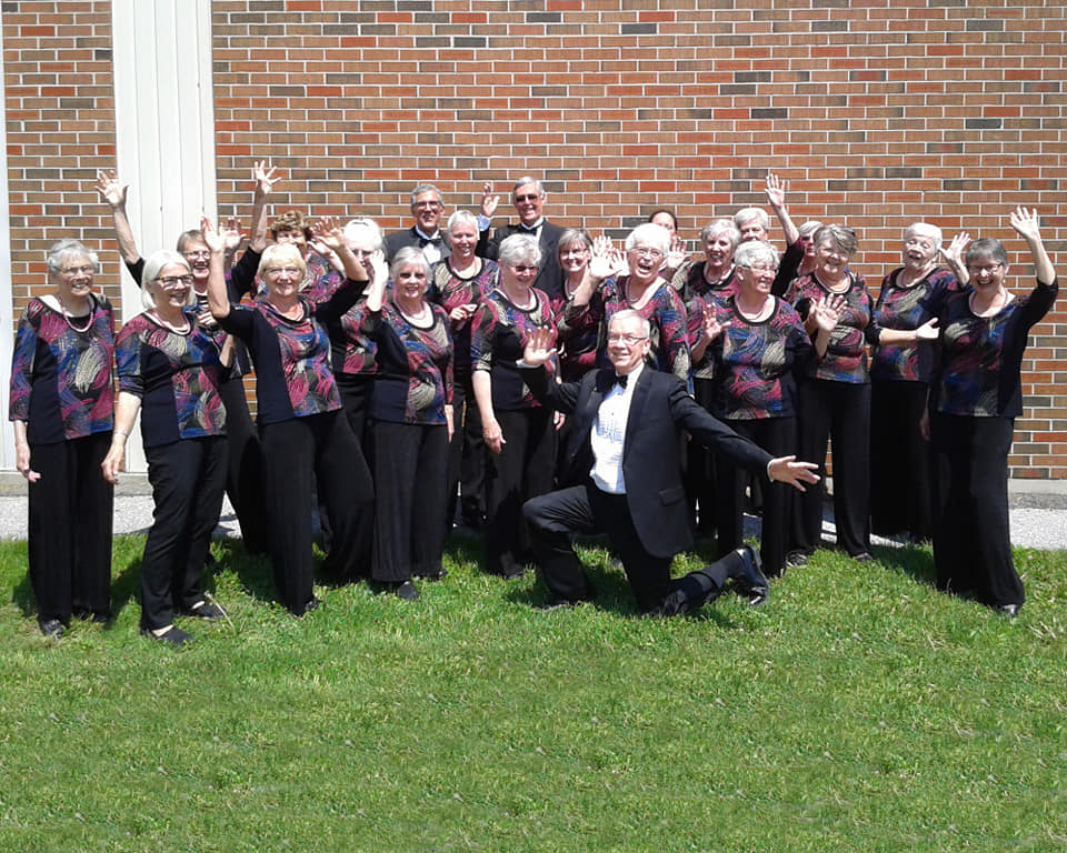 The members of Jubilee Chorale standing in front of church on a sunny day