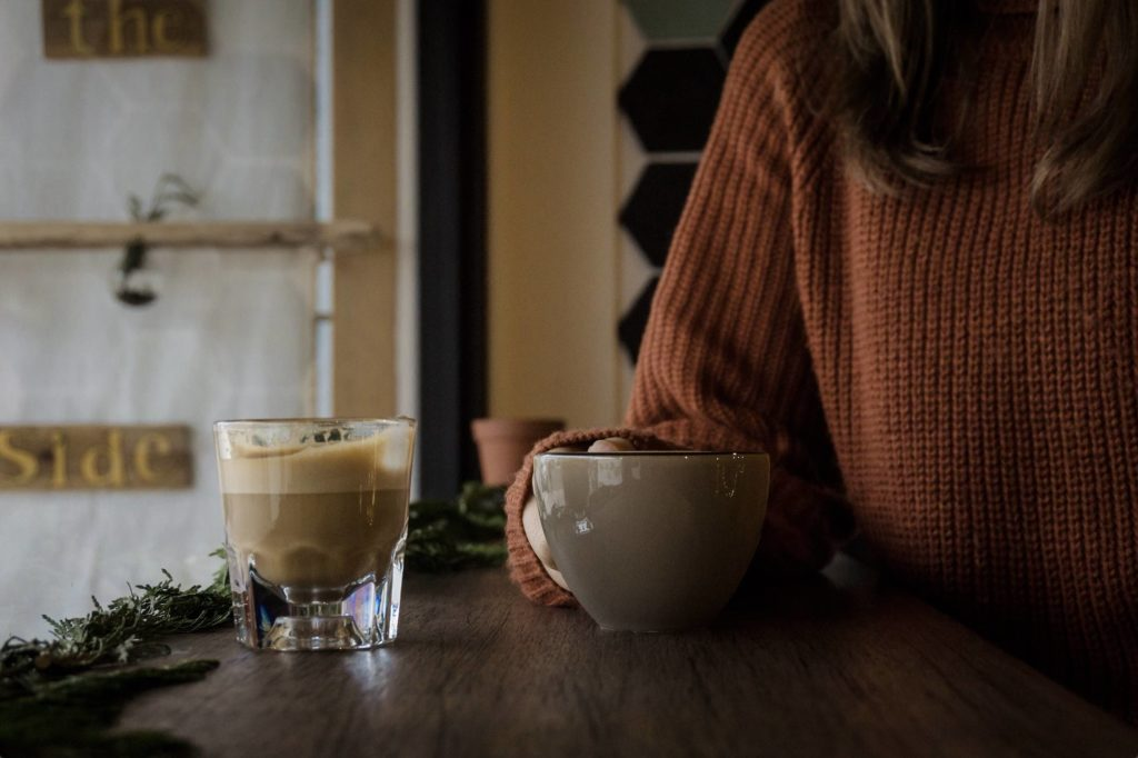 Woman holding coffee cup at Greenhaven Womens Shelter