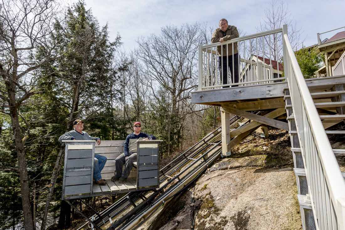 Cottage lifts elevation solutions team on a deck overlooking lake